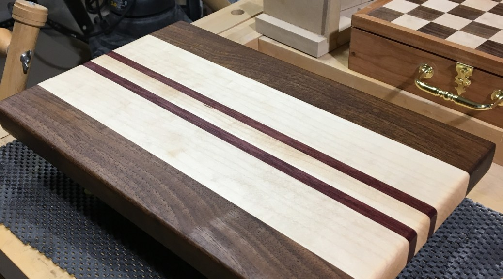 Maple, walnut and purpleheart cutting board