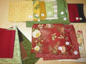 Kit fabrics marked with name and number matching pattern. The grouping on bottom left is additional fabric I have included for customization.
