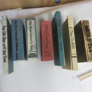All spines completed and ready to be reattached to the books