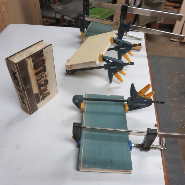 Glue up of the books with printed spines