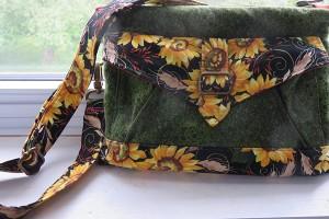 Seneca bag converts from shoulder bag to waist pouch.