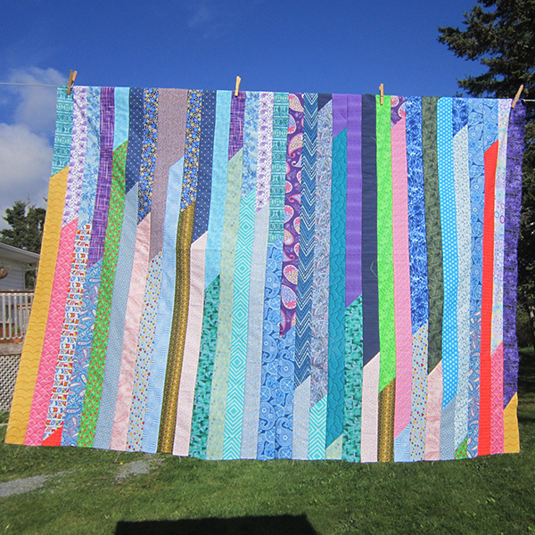 """Finished jelly roll quilt with random 2 1/2"""" strips."""