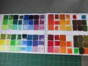 I created a palette with acrylic paint and added fabric swatches to match